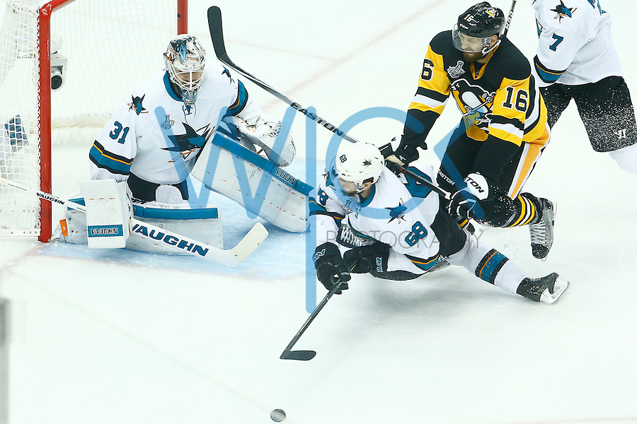 Eric Fehr #16 of the Pittsburgh Penguins hits Melker Karlsson #68 of the San Jose Sharks in front of the net in the second period during game two of the Stanley Cup Final at Consol Energy Center in Pittsburgh, Pennslyvania on June 1, 2016. (Photo by Jared Wickerham / DKPS)