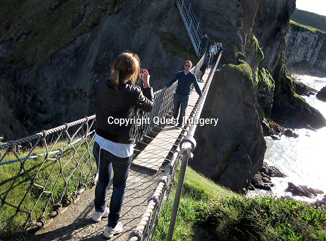Carrick-a-Rede Rope Bridge is a famous rope bridge near Ballintoy in County Antrim, Northern Ireland. The bridge links the mainland to the tiny island of Carrickarede. It spans 20 metres and is 30 metres above the rocks below. <br /> Photo by Deirdre Hamill/Quest Imagery