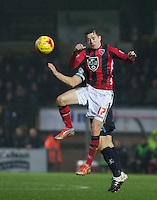 Andrew Fleming of Morecambe wins the ball in the air during the Sky Bet League 2 match between Wycombe Wanderers and Morecambe at Adams Park, High Wycombe, England on 2 January 2016. Photo by Andy Rowland / PRiME Media Images
