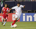 21 June 2007:  Mexico's Carlos Salcido (3), trailed by Guadeloupe's Stephane Auvray (8). The National Team of Mexico defeated Guadeloupe 1-0  in a CONCACAF Gold Cup Semifinal match at Soldier Field in Chicago, Illinois.