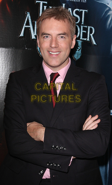 DONAL MAcINTYRE .VIP Screening of 'The Last Airbender' held at the Soho Hotel, London, England, UK, August 12th 2010.half length black suit arms folded crossed pink shirt red tie .CAP/ROS.©Steve Ross/Capital Pictures.