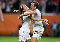 Alex Morgan (13) of the United States celebrates her goal with teammate Abby Wambach (20) during the final of the FIFA Women's World Cup at FIFA Women's World Cup Stadium in Frankfurt Germany.  Japan won the FIFA Women's World Cup on penalty kicks after tying the United States, 2-2, in extra time.