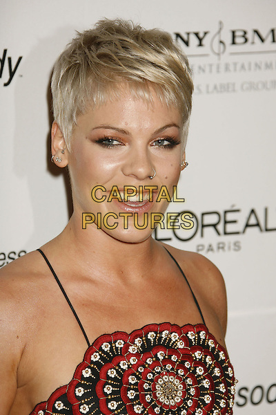 PINK.Clive Davis 2007 Pre-Grammy Awards Party held at the Beverly Hilton Hotel, Beverly Hills, California, USA..February 10th, 2007.pinnk headshot portrait nose ring piercing red detail gold silver diamond tooth teeth .CAP/ADM/RE.©Russ Elliot/AdMedia/Capital Pictures