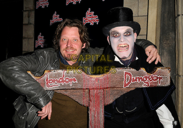 CHARLEY BOORMAN.The Jack The Ripper Experience launch party, London Dungeon, London, England..April 6th, 2008.half length stocks brown leather jacket goatee facial hair black top hat costume dress-up mouth open scary.CAP/CAN.©Can Nguyen/Capital Pictures