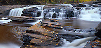 Porcupine Mountains Wilderness State Park, MI<br /> Water sculpted shale with scattered autumn leaves beneath Manido Falls on the Presque Isle River