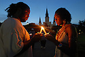 Chris Williams, born and raised in New Orleans, and his new friend Danielle Miles, a volunteer who moved to the city after the hurricane, light their candles at a vigil in Jackson Square marking the second anniversary of Hurricane Katrina, Wednesday, Aug. 29, 2007.<br /> (Cheryl Gerber for The New York Times)
