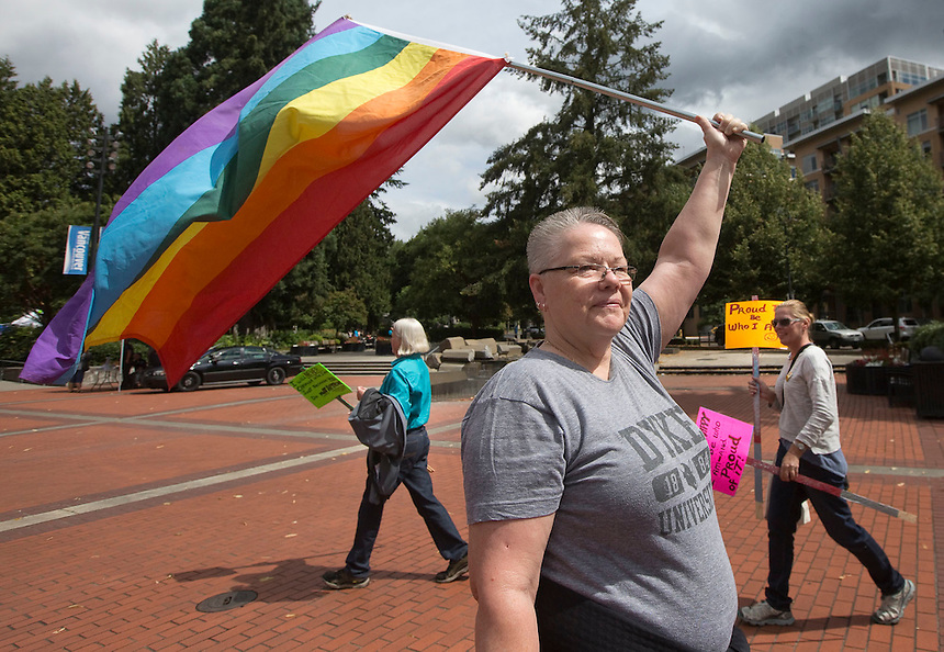 Eva Hoffman holds a rainbow flag at a Pride event Esther Short Park in downtown Vancouver Sunday July 9, 2016. he annual Saturday in the Park Pride event celebrates the local gay, lesbian, bisexual and transgender community. (Photo by Natalie Behring/ for the The Columbian)