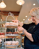 USA, California, Los Angeles, Owner Joan Mcnamara arranging cupcakes in her cafe Joan's On Third.