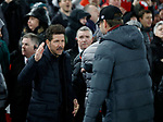 Diego Simeone manager of Atletico Madrid goes in for the handshake before bumping elbows with Jurgen Klopp manager of Liverpool during the UEFA Champions League match at Anfield, Liverpool. Picture date: 11th March 2020. Picture credit should read: Darren Staples/Sportimage