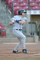 Cedar Rapids Kernels shortstop Michael Davis (17) swings at a pitch against the Quad Cities River Bandits at Veterans Memorial Stadium on April 16, 2019 in Cedar Rapids, Iowa.  The Kernels won 11-2.  (Dennis Hubbard/Four Seam Images)