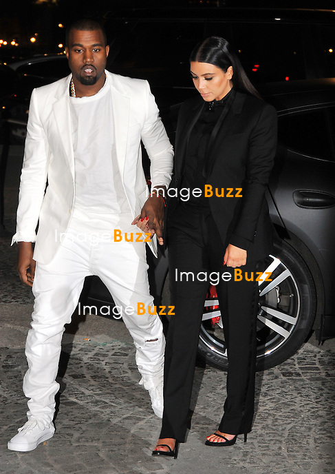 Kim Kardashian ( pregnant ) & Kanye West attend the Givenchy fFall/Winter 2013 Ready-to-Wear Fashion Show during Paris fashion week, on March 3, 2013.