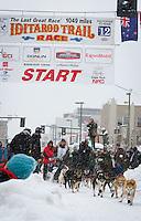 Ray Redington Jr. leaves the 2011 Iditarod ceremonial start line in downtown Anchorage, during the 2012 Iditarod..Jim R. Kohl/Iditarodphotos.com