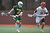 Zach Hobbes #4 of Ward Melville, left, races downfield as Christopher Nicholas #9 of Chaminade pressures him during a non-league varsity boys lacrosse game at Chaminade High School on Saturday, April 7, 2018. Ward Melville won by a score of 11-7.