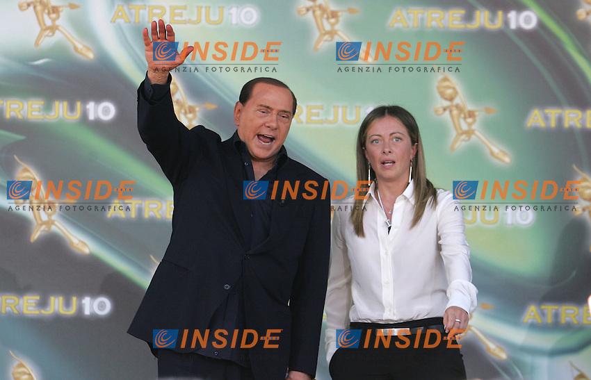 SILVIO BERLUSCONI E GIORGIA MELONI<br />ROMA 12/09/2010 Silvio Berlusconi chiude la manifestazione di Atreju 2010.<br />Italian permier Silvio Berlusconi participate to the last day of Atreju 2010, talking to the right wing youngers.<br />Photo Samantha Zucchi Insidefoto