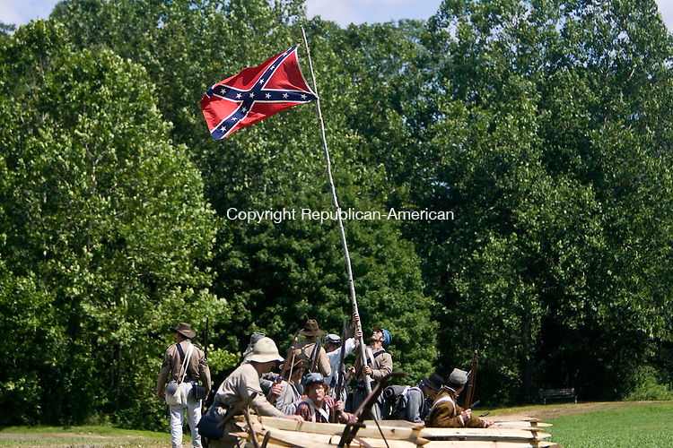 WOODBURY, CT - 16 AUGUST 2009 -081609JT18-<br /> FOR COUNTRY LIFE: Men portraying Confederate soldiers raise the Confederate flag as they reenact the Civil War Battle of 3rd Winchester at Three Rivers Park in Woodbury on Saturday.<br /> Josalee Thrift Republican-American