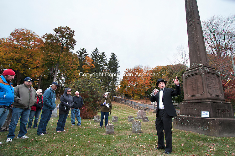WINSTED, CT - 24 OCTOBER 2015 - 102415JW04.jpg -- Steven Silvester portrays Winsted William H. Phelps to a crowd of onlookers Saturday afternoon during a historical tour of Winsted Old Burying Ground. Jonathan Wilcox Republican-American