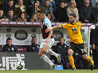 Burnley's Ashley Westwood under pressure from Wolverhampton Wanderers' Joao Moutinho<br /> <br /> Photographer Rich Linley/CameraSport<br /> <br /> The Premier League - Burnley v Wolverhampton Wanderers - Saturday 30th March 2019 - Turf Moor - Burnley<br /> <br /> World Copyright © 2019 CameraSport. All rights reserved. 43 Linden Ave. Countesthorpe. Leicester. England. LE8 5PG - Tel: +44 (0) 116 277 4147 - admin@camerasport.com - www.camerasport.com