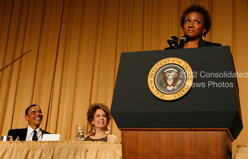 Washington, DC - May 9, 2009 -- United States President Barack Obama and White House Correspondents' Association President Jennifer Loven react to the comedy of Wanda Sykes as she entertains the crowd at the annual WHCA gala dinner at the Washington Hilton Hotel, Washington, DC, Saturday, May 9, 2009..Credit: Martin H. Simon - Pool via CNP