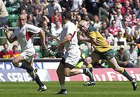 25/05/2002 (Saturday).Sport -Rugby Union - London Sevens.England vs Australia.Henry Paul running with the ball and supported by Phil Greening. Ben Petersen running back[Mandatory Credit, Peter Spurier/ Intersport Images].