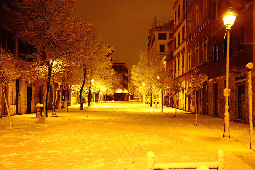 The central street of the most typical area of the Pigneto quarter, in Rome, in the very early morning after a snowing night (February, 2012). Digitally Improved Photo.