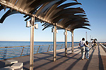 Young Couples walking on the Harbour Wall Pier Promenade Walk in Alicante, Spain
