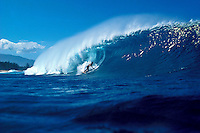 Surfing the famous tube at Pipeline, North shore Oahu