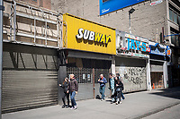 Vacant storefronts in a taxpayer, including a Subway sandwich shop, are seen in New York in a building ready for demolition on Sunday, April 23, 2017. (© Richard B. Levine)