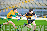 Gneeveguillas Padraig O'Connor tries to get to grips with Dr Crokes Jamie Doolan during their O'Donoghue Cup final clash in the Fitzgerald Stadium, Killarney on Sunday.