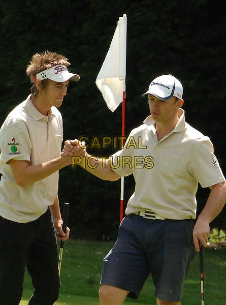 MATT DAWSON .competes in the Mini Masters Charity Golf Event - a par-3 celebrity golf tournament in aid of LEUKA. The match will raise money for research into and treatment of Leukaemia..Duke's Meadow Golf Club, London, England, UK, July 14, 2008..half length sport playing golfing visor shaking hands.CAP/WIZ.©WizardCapital Pictures