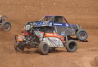 Apr 17, 2011; Surprise, AZ USA; LOORRS driver Geoffrey Cooley (322) and Dave Mason Jr (365) during round 4 at Speedworld Off Road Park. Mandatory Credit: Mark J. Rebilas-