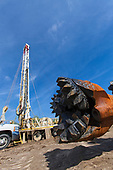 Drill bit in front of water well being drilled in Almond orchard. After three years of severe drought and groundwater depletion, a record number of well drilling permits have been granted, Tulare County, San Joaquin Valley, California, USA