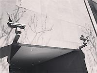 Birds perched atop surveillance cameras in New York City on April 18, 2016.