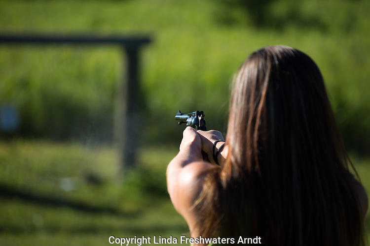 Woman shooting a Ruger single six .22 revolver