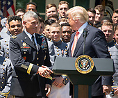 Lieutenant General Robert Caslen, United States Army, Superintendent of the US Military Academy, shakes hands with US President Donald J. Trump as the President presents the Commander-in-Chief's Trophy to the U.S. Military Academy football team in the Rose Garden of the White House in Washington, DC on Tuesday, May 1, 2018.  The Commander-in-Chief's trophy is presented to the winner of the annual Army-Navy football game which was played at Lincoln Financial Field in Philadelphia, Pennsylvania on December 9, 2017.  The Army Black Knights beat the Navy Midshipmen 14 - 13.<br /> Credit: Ron Sachs / CNP
