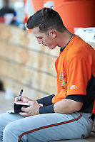 Chris Clare (2) of the Frederick Keys makes notes after an at bat during the game against the Winston-Salem Dash at BB&T Ballpark on July 26, 2018 in Winston-Salem, North Carolina. The Keys defeated the Dash 6-1. (Brian Westerholt/Four Seam Images)