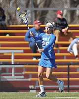 Duke University midfielder Kelci Smesko (26) passes the ball. Boston College (white) defeated Duke University (blue), 10-9, on the Newton Campus Lacrosse Field at Boston College, on April 6, 2013.