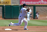 Reno Aces' Taylor Harbin turns a double play in a game against the Sacramento River Cats in Reno, Nev., on Sunday, April 14, 2013. The River Cats won 22-6..Photo by Cathleen Allison