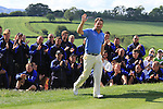 Graeme McDowell waves as he goes to collect his winning cheque from Sir Terry Matthews of Celtic Manor resort on the final day of the Celtic Manor Wales Open 2010.Picture Fran Caffrey/Newsfile.ie