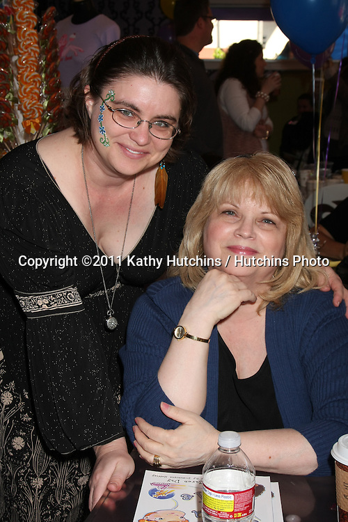 """LOS ANGELES - NOV 5:  Dominique Heffley and mother arrives at the """"YOU AND ME"""" Book Party at SweetHarts on November 5, 2011 in Sherman Oaks, CA"""