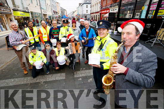 Tralee Gardai held their annual Christmas collection and Garda Band performance in aid of the Tralee International Resource Centre in The Mall on Wednesday in foreground are Garda Mary Gardiner and Dave Rath.