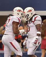STAFF PHOTO BEN GOFF  @NWABenGoff -- 09/27/14 Arkansas linebacker Martrell Spaight, left, and running back Alex Collins psych each other up while taking the field before the Southwest Classic against Texas A&M at AT&T Stadium in Arlington, Texas on Saturday September 27, 2014.
