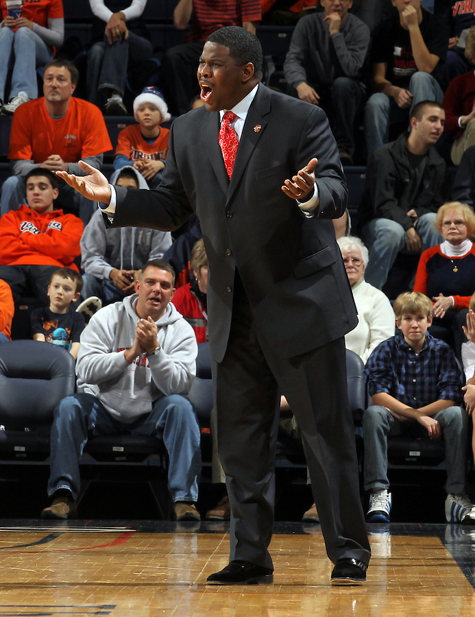 Dec. 22, 2010; Charlottesville, VA, USA; Seattle Redhawks head coach Cameron Dollar reacts to a play during the game against the Virginia Cavaliers at the John Paul Jones Arena. Mandatory Credit: Andrew Shurtleff
