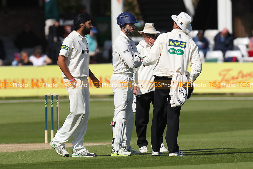 Umpires Llong and Evans in conversation with Monty Panesar (L) and James Foster of Essex after the wicket of Stephen Moore, Panesar had exchanged words with Billy Godleman - Essex CCC vs Derbyshire CCC - LV County Championship Division Two Cricket at the Essex County Ground, Chelmsford - 15/04/14 - MANDATORY CREDIT: Gavin Ellis/TGSPHOTO - Self billing applies where appropriate - 0845 094 6026 - contact@tgsphoto.co.uk - NO UNPAID USE