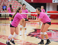 NWA Democrat-Gazette/BEN GOFF @NWABENGOFF<br /> Okiana Valle (left), Arkansas senior libero, and teammate Logan Brown laugh during a drill Wednesday, Nov. 7, 2018, at practice in Barnhill Arena.