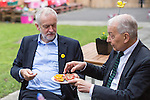 © Joel Goodman - 07973 332324 . 24/09/2016 . Liverpool , UK . JEREMY CORBYN and FRANK FIELD (r) eat pizza breads Corbyn made during a visit to Beaconsfield Community House in Birkenhead , following his victory declaration . The centre provides clothes and food that would otherwise be destined for waste from supermarkets , to local residents in need . Photo credit : Joel Goodman