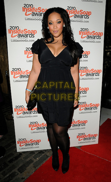 DONNALEIGH BAILEY.Attending the Inside Soap Awards 2010 held at Shaka Zulu, Camden, London, England, UK. .September 27th 2010 .arrivals full length black cleavage dress clutch bag tights .CAP/CAN.©Can Nguyen/Capital Pictures.