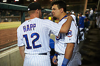 Mesa Solar Sox Ian Happ (12) talks with designated hitter Kyle Schwarber (66), of the Chicago Cubs in town to prepare for a return to the major league club in the World Series, during a game against the Salt River Rafters on October 22, 2016 at Sloan Park in Mesa, Arizona.  Salt River defeated Mesa 7-2.  (Mike Janes/Four Seam Images)