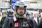 "© Joel Goodman - 07973 332324 . 11/06/2017 . Manchester , UK . A policeman is struck by an egg thrown from the crowd . Demonstration against Islamic hate , organised by former EDL leader Tommy Robinson's "" UK Against Hate "" and opposed by a counter demonstration of anti-fascist groups . UK Against Hate say their silent march from Piccadilly Train Station to a rally in Piccadilly Gardens in central Manchester is in response to a terrorist attack at an Ariana Grande concert in Manchester , and is on the anniversary of the gun massacre at the Pulse nightclub in Orlando . Photo credit : Joel Goodman"