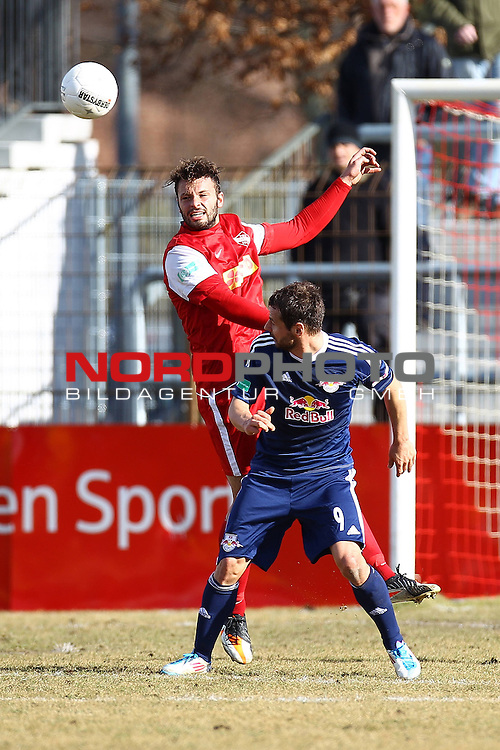 26.02.2012, Wilhelm-Langrehr-Stadion, Garbsen, GER, RL Nord, TSV Havelse vs RB Leipzig, im Bild Jan-Thede Smidt (5, TSV Havelse) im Kopfballduell mit Roman Wallner (9, RB Leipzig)<br /> <br /> // during the Match GER, RL Nord, TSV Havelse vs RB Leipzig,  Wilhelm-Langrehr-Stadion, Garbsen, Germany, on 2012/02/26<br /> Foto &copy; nph / Sielski *** Local Caption ***