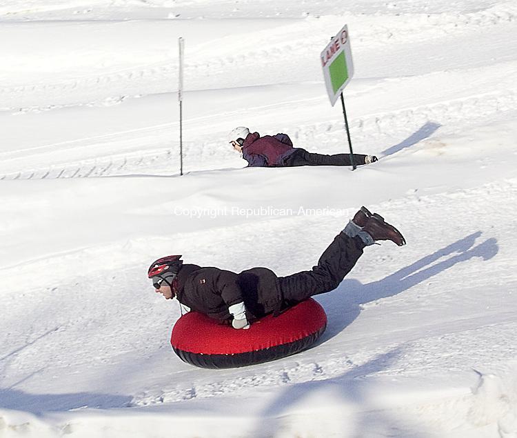 WOODBURY CT.-16 DECEMBER  2010 121610DA04- Jeff Hudson (front) of Austin Texas sleds down a mountain with his sister Elizabeth Smith of Washington at Woodbury Ski Area on Thursday.